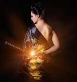 Woman with japan sword katana in hands — Stock Photo