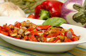 Eggplant salad and peppers — Stock Photo