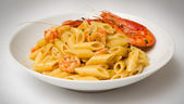 Penne with shrimps — Stock Photo