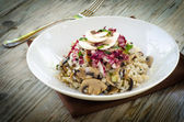Risotto with mushrooms,zucchini,radicchio and parsley — Stock Photo