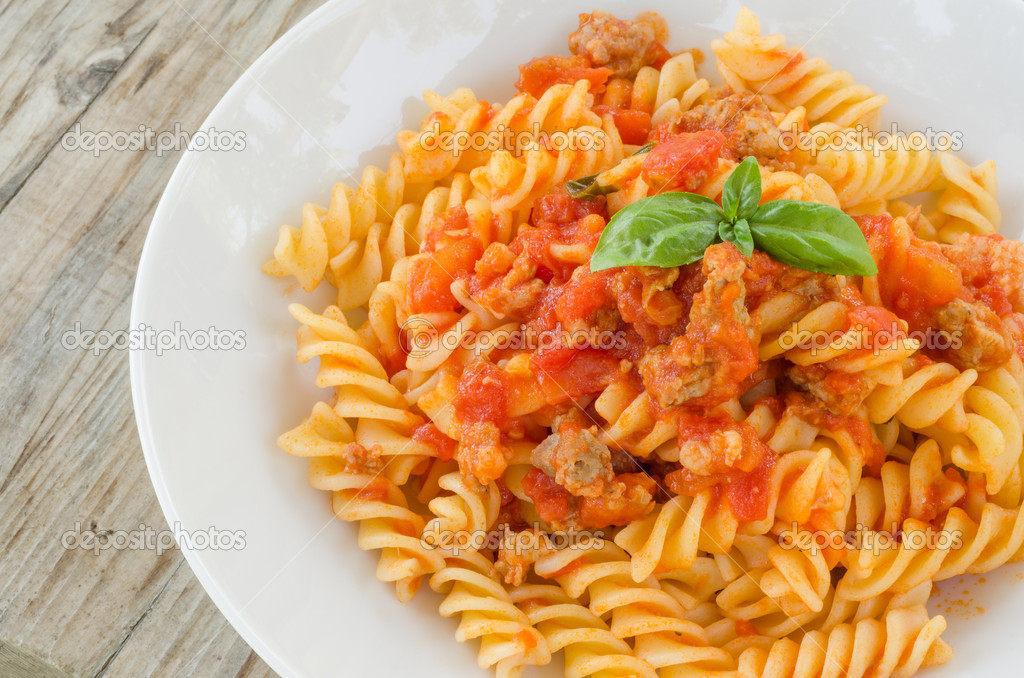 Download - Fusilli with tomato sauce and sausage — Stock Image ...