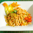 Trofie with shrimps and zucchini flowers — Stock Photo