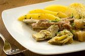 Stew of pork with artichoke and potato, italian cuisine — Stock Photo