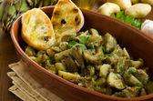 Artichoke and potato stew — Stock Photo
