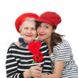 Stock Photo: Granddaughter and grandma with red heart