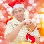 Smiling grandmother in Santa cap — Stock Photo #37469441
