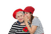 Grandmother and her granddaughter whispering — Stock Photo