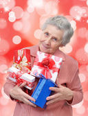 Grandmother with gifts — Stock Photo