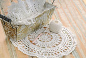 White lace in vintage basket — Stock Photo