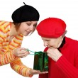 Happy grandmother and granddaughter with present — Stock Photo #8884984