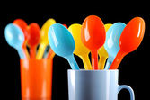 Colored plastic spoons — Stock Photo
