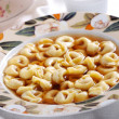 Tortellini in broth - Foto Stock