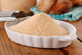 Breadcrumbs in white bowl — Stock Photo