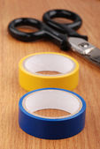 Insulation tape on wooden table — Stock Photo