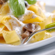 Pasta with cream and mushrooms — Stock Photo