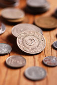 Coins on the wooden table — Stock Photo