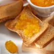 Orange marmalade on toast — Stock Photo