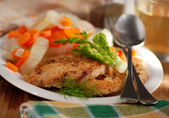 Crumbed chicken on the plate — Stock Photo
