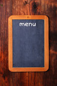 Blackboard on the table — Stock Photo