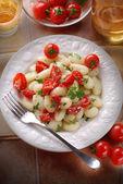 Potato gnocchi with cherry tomatoes — Stock Photo