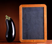 Eggplant on wooden table — Stock Photo