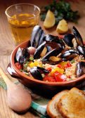 Couscous with mussels in earthenware bowl — Stock Photo