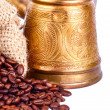 Arabic copper turks and scattered coffee grains — Stock Photo #12599136