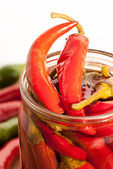 Preserved red hot chili peppers on white background — Stock Photo