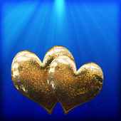 Two golden hearts as a symbol of love — Stock Photo