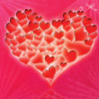 Red glossy heart a colored background — Stock Photo