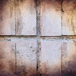 Grunge texture of pastel colour broken tiles on old wall — Stock Photo