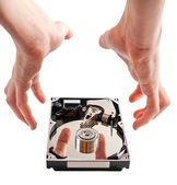 Hard drive details and hands, concept of data security — Stock Photo