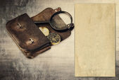 Vintage background with old paper, wallet and compass — Stock Photo