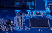 Macro photo of electronic circuit. PCB on the lighting. — Stock Photo