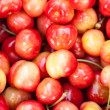 Seamless texture of sweet cherries — Stock Photo
