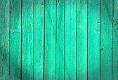 Old green wooden fence background — Stock Photo