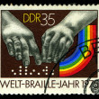 DDR- CIRCA 1975: A stamp printed in DDR, shows  hands reading a font of Braille , circa 1975 — Stock Photo