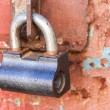 Padlock on old metal door — Stock Photo