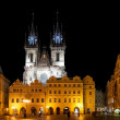 PRAGUE - February 13: Old Town Square with people, illuminated buildings and Tyn Church on background at evening. The square is very popular with tourists in Prague, Czech Republic on February 13, 201 — Stock Photo