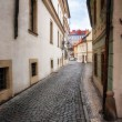 Morning in old city without people . Prague. textured old paper background — Stock Photo