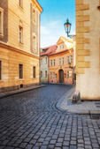 Old city without people . Prague. textured old paper background — Stock Photo