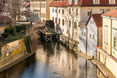 Old watermill on Chertovka river in Prague. — Stock Photo