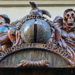 Marquee sign for a Marionette Theatre in Prague features several phantasmagoria creatures including Death and a Jester. — Stock Photo