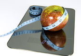 Apple on the scale. — Stock Photo