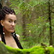 Portrait of a girl with dreadlocks on the background of birch tr — Stock Photo #16619925