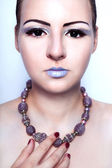 Beautiful alien woman with beads on the neck and black eyes — Stock Photo