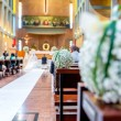 Stock Photo: White flowers in church