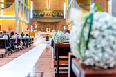 White flowers in church — Stock Photo