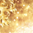 Stock Photo: Golden ornament with liquid reflections