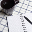 Notebook lying on the tablecloth — Stock Photo #19957233